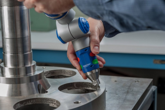 industrial photo of precision measuring tool in use