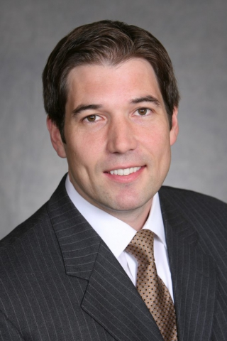 male executive, textured gray background