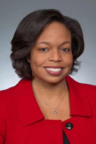 female affrican american executive, gray background