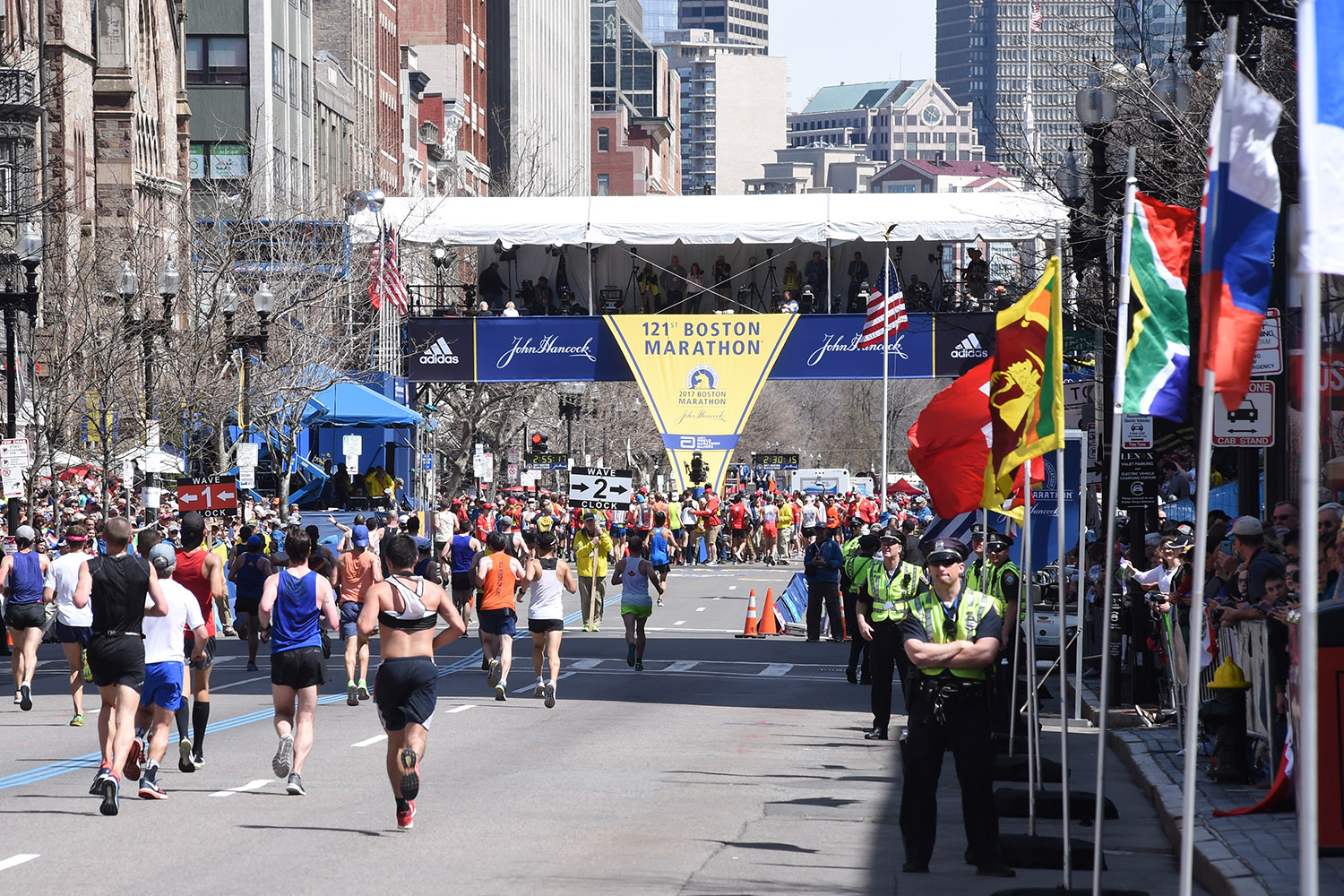 Boston Marathon runners approach the finish line