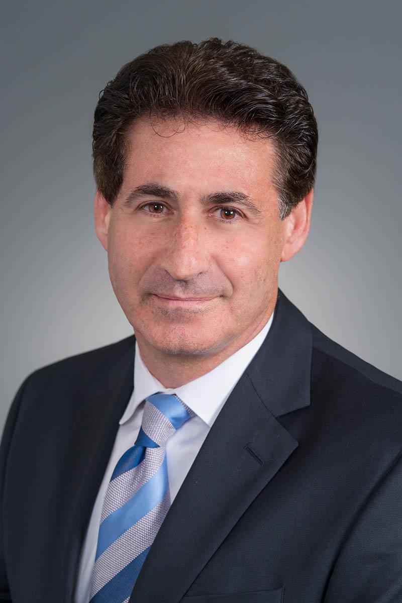 male executive portrait - standard gray background