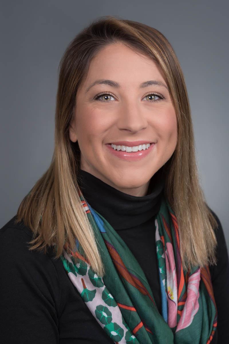 female executive portrait - standard gray background